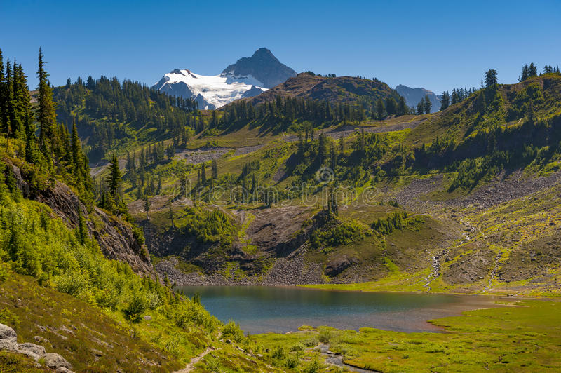 Mt. Shuksan, Washington. Mount Shuksan may be one of the most photographed mountains in the Cascade Range seen here on the Chain Lakes Loop Trail. Mt. Baker stock photo