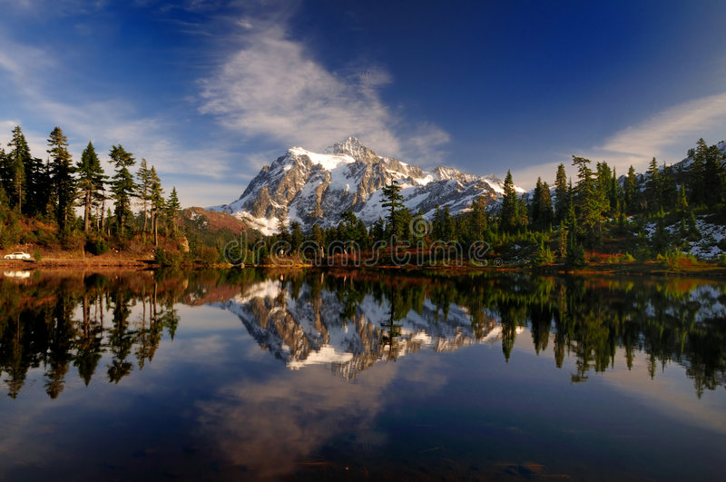 Mt Shuksan wide view. A wide angle portrait of Mount Shuksan and its reflection royalty free stock images