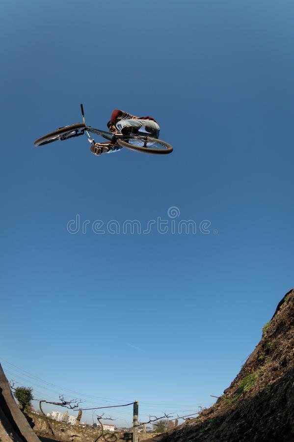 MTB Bike jump over a dirt trail royalty free stock images