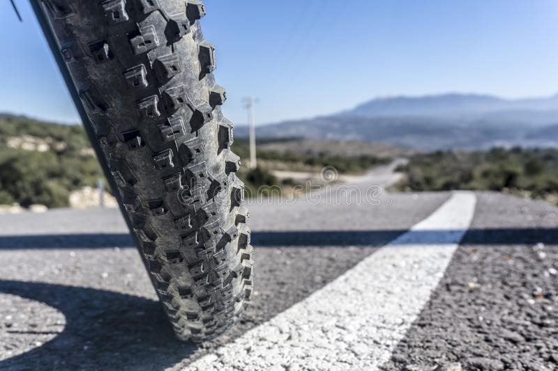 Mtb bike Tire. Low angle view ot mountain bike tire on the asphalt stock photography