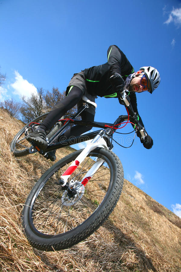 Mtb extreme. Biking downhill on hard tail stock photography