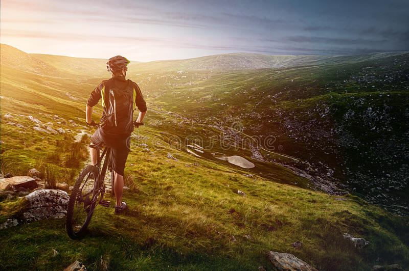 MTB. Mountain biker Begins his tour stock photography