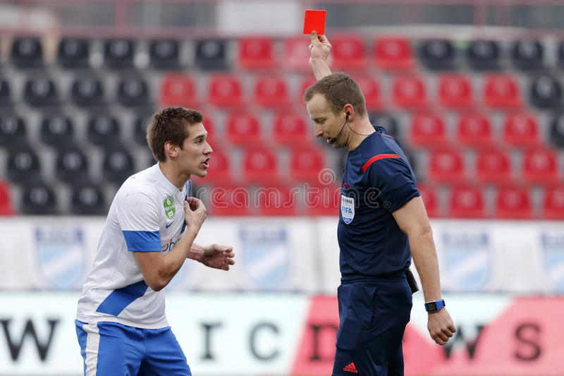 MTK vs. Videoton OTP Bank League football match. BUDAPEST, HUNGARY - MARCH 14, 2015: Zsolt Poloskei of MTK (l) uncomprehends before referee Tamas Bognar during royalty free stock photos