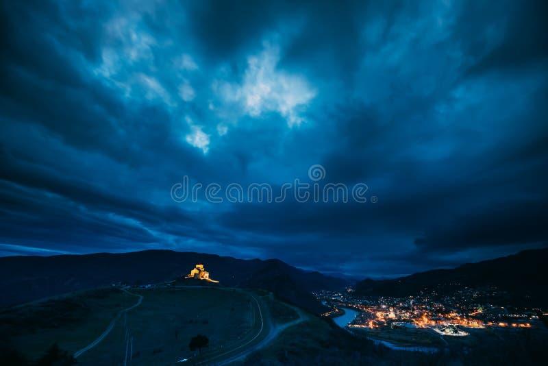 Mtskheta, Georgia. Ancient Jvari, Georgian Orthodox Monastery In Night Illuminations Lighting. World Heritage Site By stock image