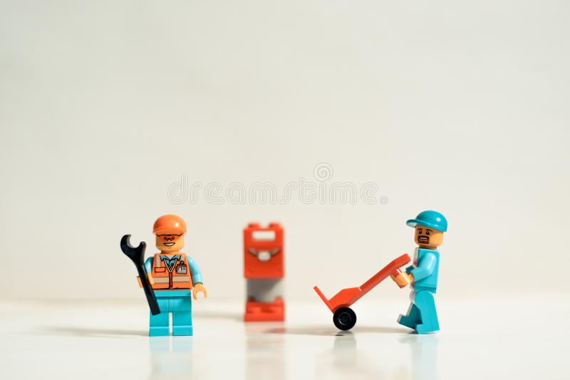 Mty Mexico, September 26 2019: Studio shot of Lego people, building workers. This set represent a site under construction. Legos. Are a popular line of plastic royalty free stock photo
