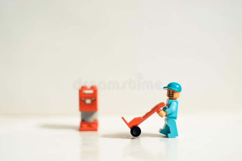 Mty Mexico, September 26 2019: Studio shot of Lego people, a construction worker with mailbox and hand truck. This set represent a. Site under construction royalty free stock photography