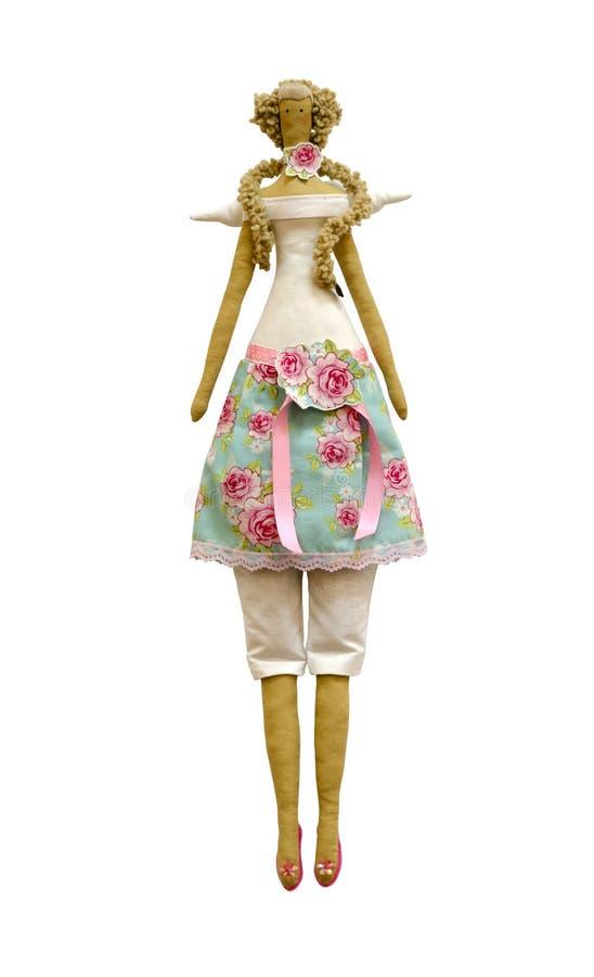 Muñeca aislada hecha a mano en vestido y pantalones con las alas y las rosas fotografía de archivo