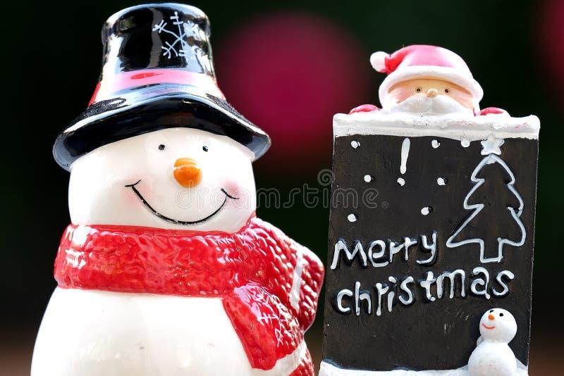 Muñeca del muñeco de nieve y de Papá Noel imágenes de archivo libres de regalías