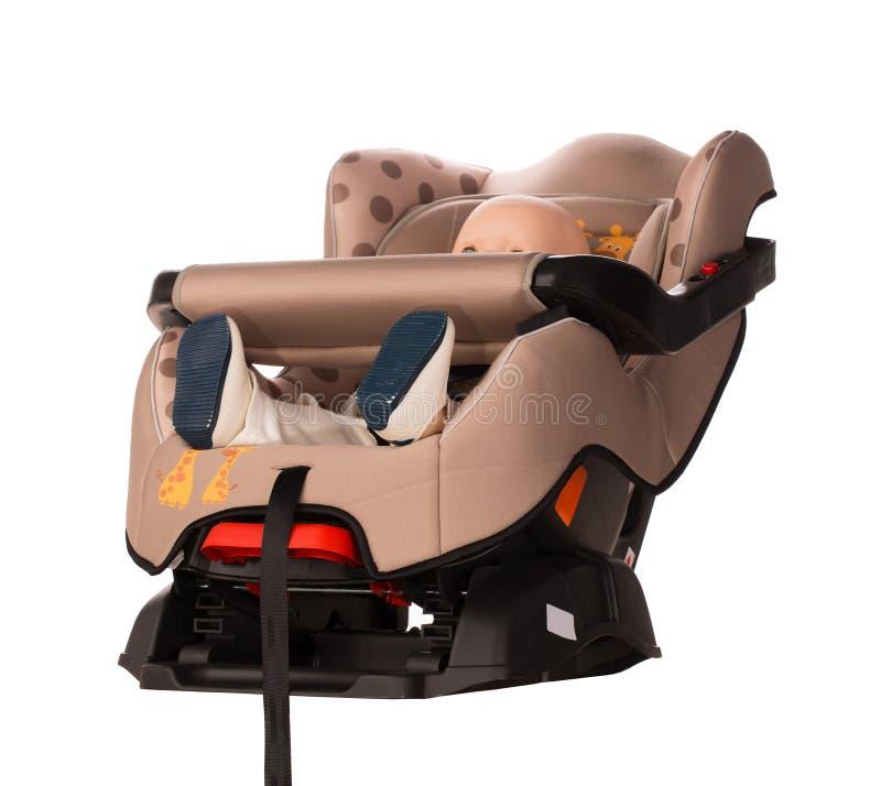 Muñeca en un asiento del aumentador de presión para un coche fotografía de archivo libre de regalías