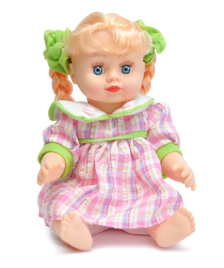 Muñeca en una alineada rosada foto de archivo libre de regalías