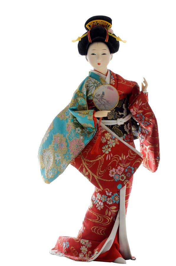 Muñeca japonesa del geisha en un fondo blanco fotos de archivo libres de regalías