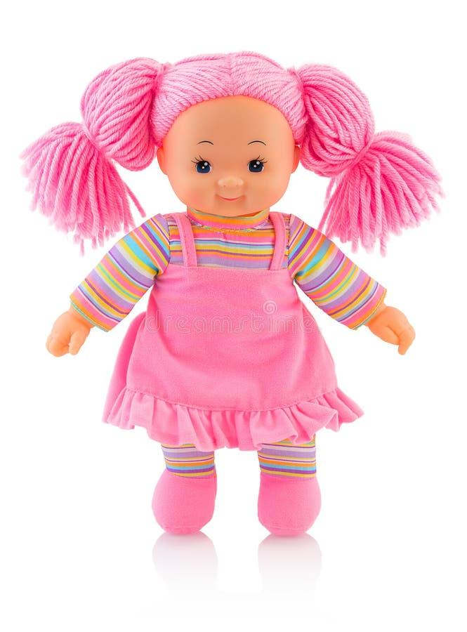 Muñeca rosada del plushie aislada en el fondo blanco con la reflexión de la sombra Bebé contemporáneo agradable del trapo con el  imágenes de archivo libres de regalías