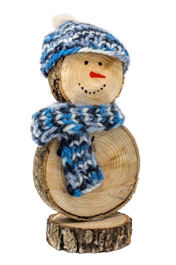 Muñeco de nieve de madera hecho a mano con el sombrero y la bufanda del ganchillo fotografía de archivo libre de regalías
