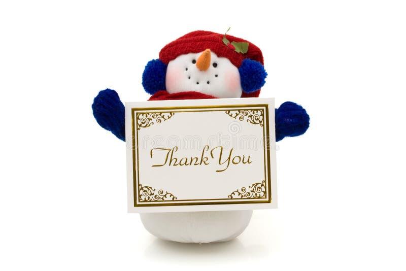 Muñeco de nieve que lleva a cabo un agradecimiento usted para cardar imagen de archivo