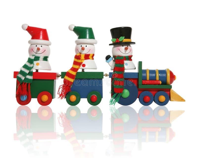Muñecos de nieve en el tren fotografía de archivo libre de regalías