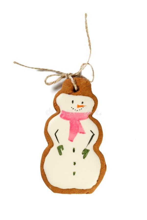 Muñecos de nieve helados tradicionales de las galletas de la Navidad del pan de jengibre aislados imagenes de archivo