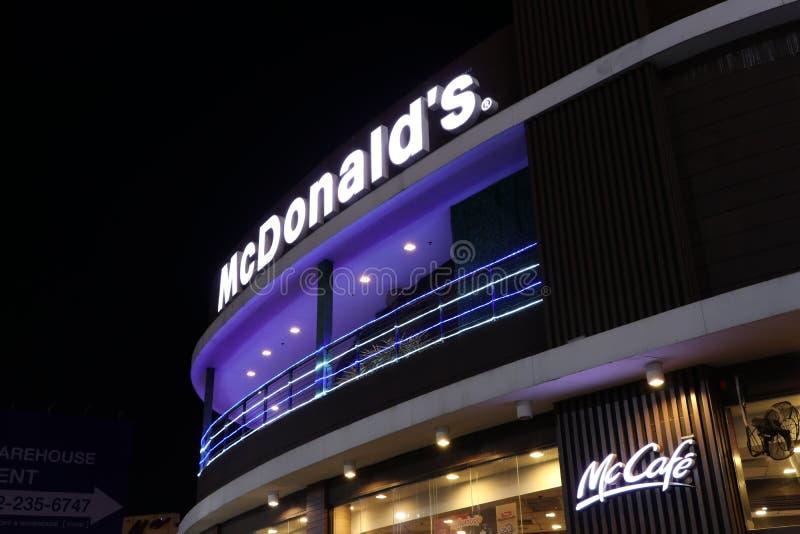 The light box McDonald`s sign on the McDonald`s Restaurant on night view at Porto Chino Community Market royalty free stock image
