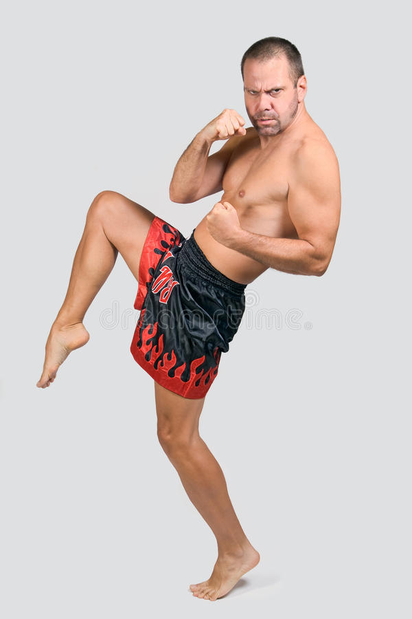Muay Thai fighter. At fighter pose royalty free stock images