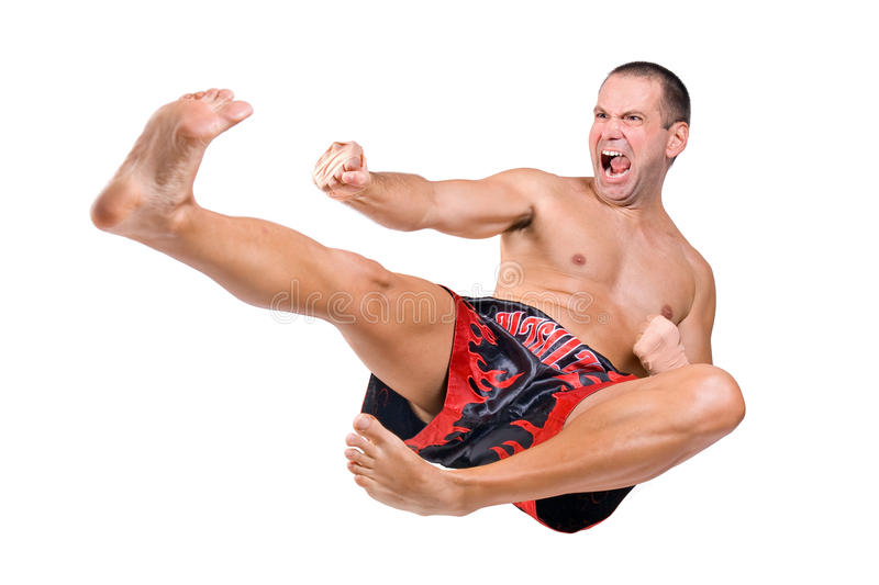 Muay Thai fighter. Jump on white background royalty free stock photography