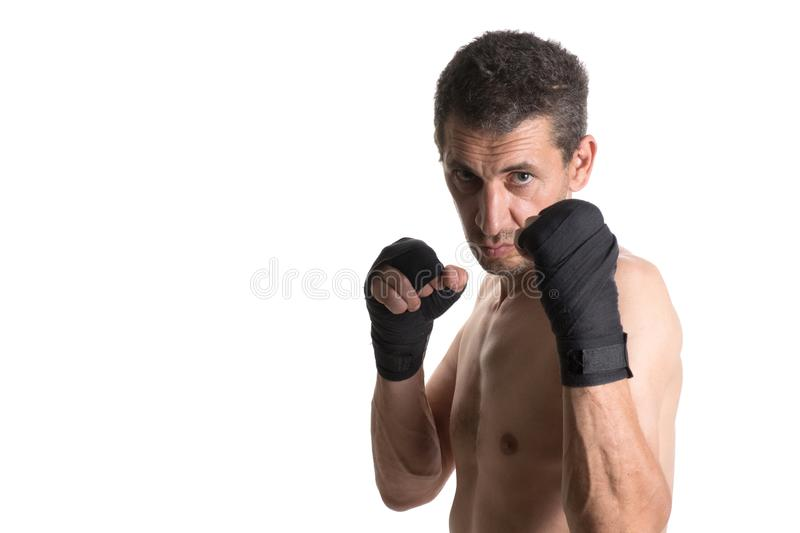 Muay thai or kickbox fighter in various postures. Muay Thai or kickboxer fighter in various poses. Portrait stock images
