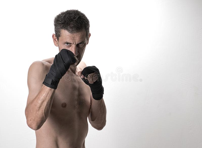 Muay thai or kickbox fighter in various postures. Muay Thai or kickboxer fighter in various poses. Portrait royalty free stock image