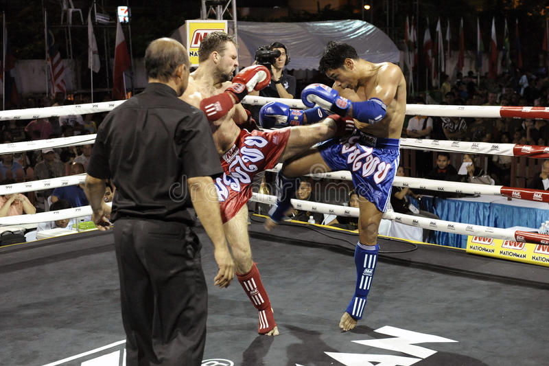 Muay Thai Match. BANGKOK - MARCH 23: Unidentified Muay Thai fighters compete in a match in the World Amateur Muay Thai Championships at the National Stadium on royalty free stock photography
