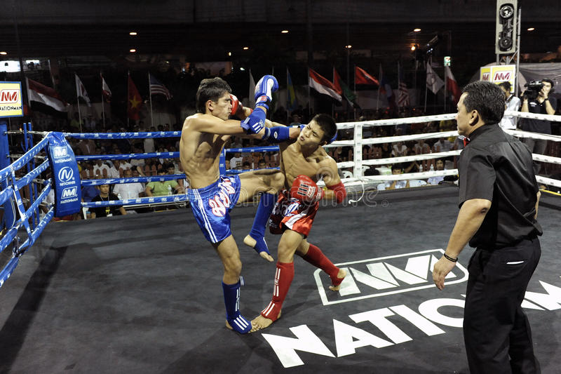 Muay Thai Match. BANGKOK - MARCH 23: Unidentified Muay Thai fighters compete in a match in the World Amateur Muay Thai Championships at the National Stadium on stock photos