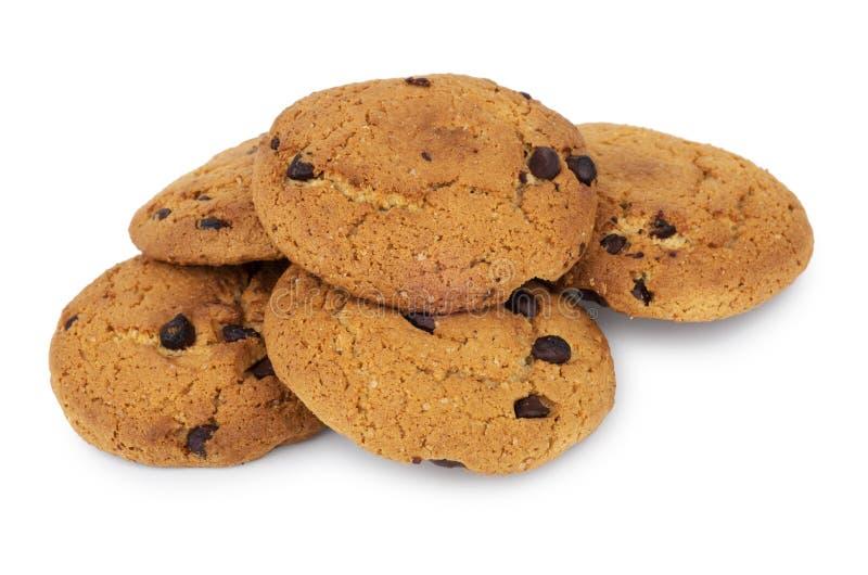 Mucchio dei biscotti di farina d'avena con cioccolato isolato su bianco fotografie stock libere da diritti