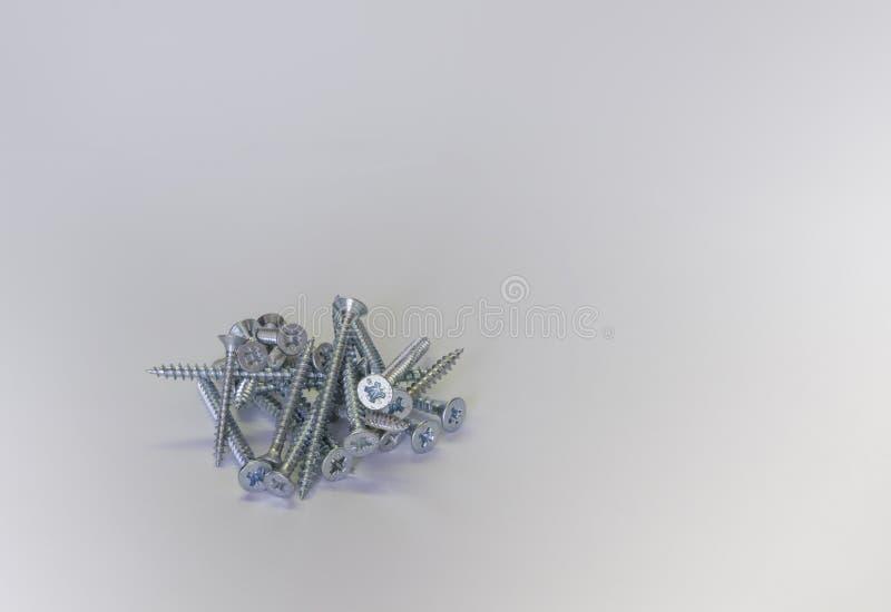 Mucchio dei bulloni d'argento fotografia stock libera da diritti