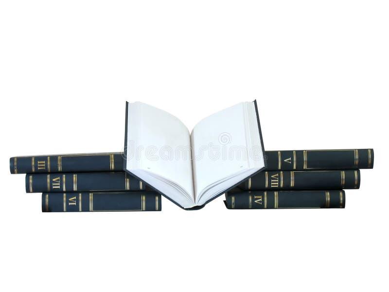 Mucchio dei libri e di quello aperto fotografie stock