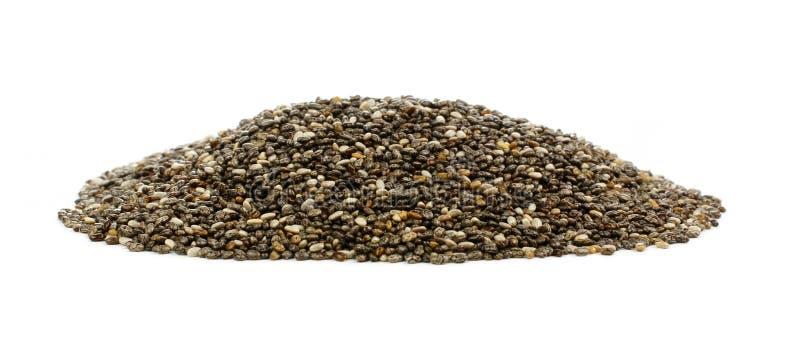 Mucchio dei semi di chia sopra bianco fotografia stock libera da diritti