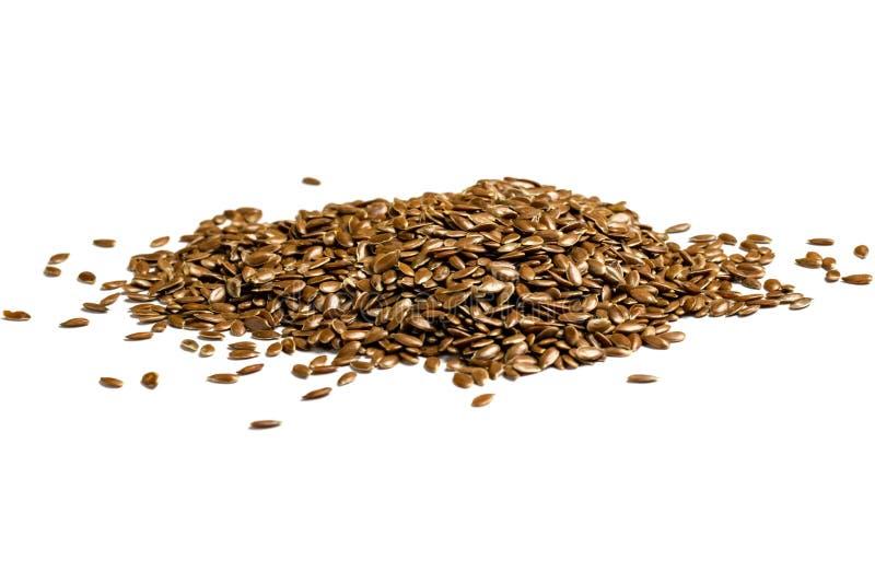 Mucchio dei semi di lino, semi di lino su fondo bianco immagine stock libera da diritti