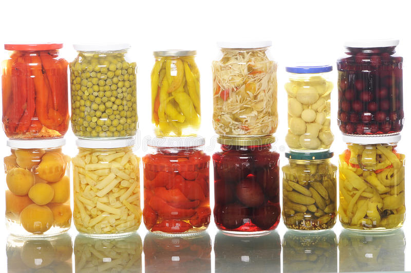 Mucchio dei vasi con i sottaceti asorted fotografia stock