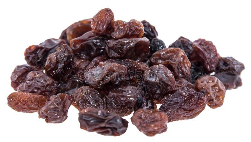 Mucchio dell'uva passa isolata su bianco fotografie stock