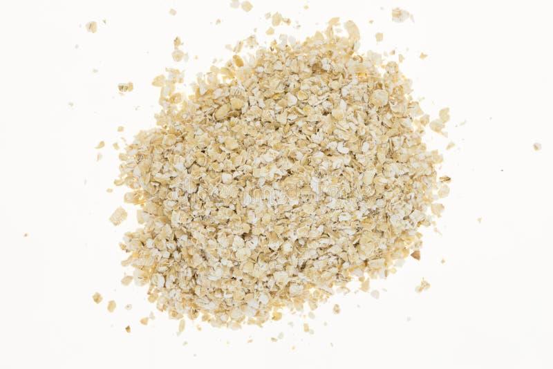 Mucchio della farina d'avena, su bianco fotografia stock