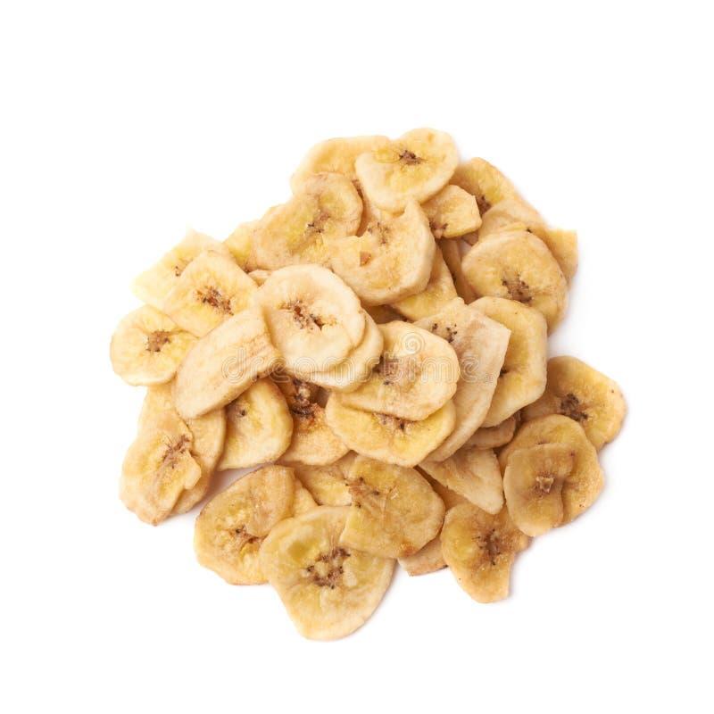 Mucchio dello spuntino affettato secco della banana isolato fotografia stock