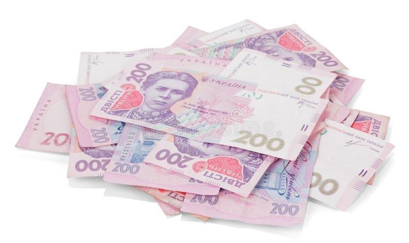 Mucchio di soldi ucraini nella denominazione 200 UAH Isolato fotografie stock libere da diritti