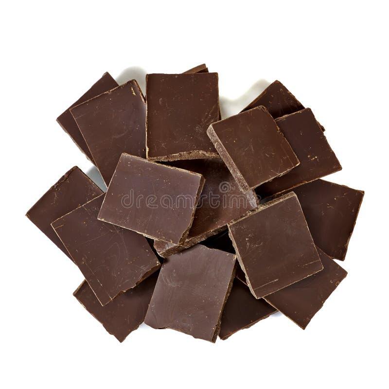 Mucchio o mucchio impilato delle barre di cioccolato immagini stock libere da diritti