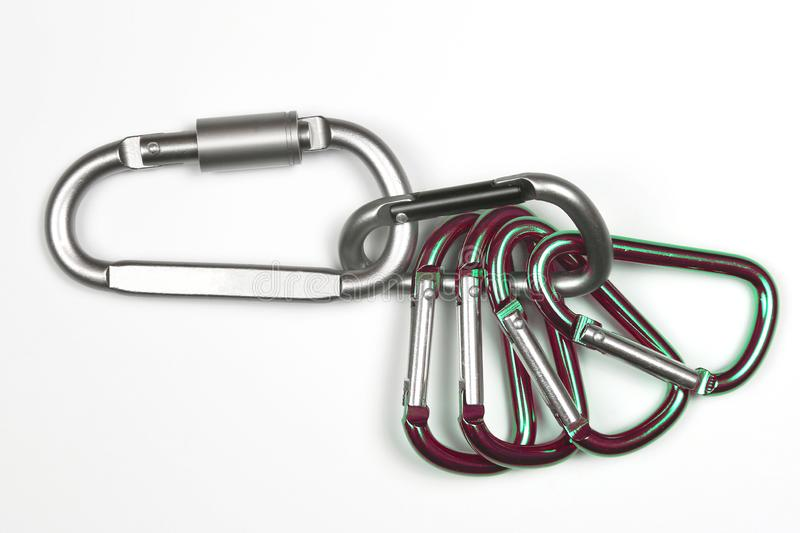 Much bonded to each other aluminum carabiners stock image