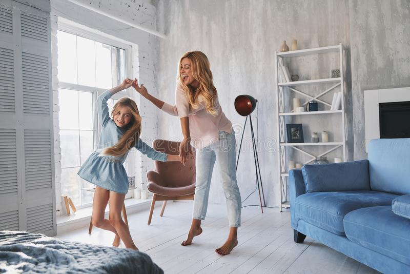 So much fun! Full length of mother and daughter holding hands an stock photos
