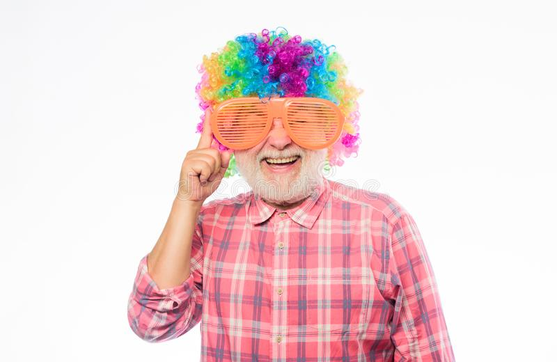 So much fun. happy birthday. corporate party. mature bearded man in colorful wig and party glasses. Crazy man in playful stock images