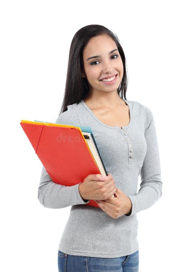 Muchacha árabe del adolescente del estudiante que presenta con las carpetas imagenes de archivo