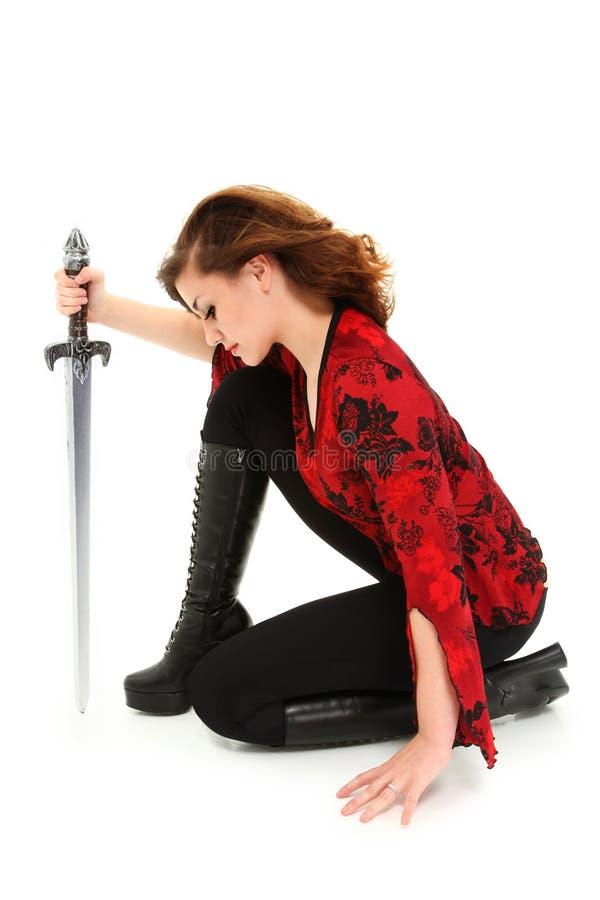 Muchacha adolescente con el camino de recortes de la espada fotos de archivo libres de regalías