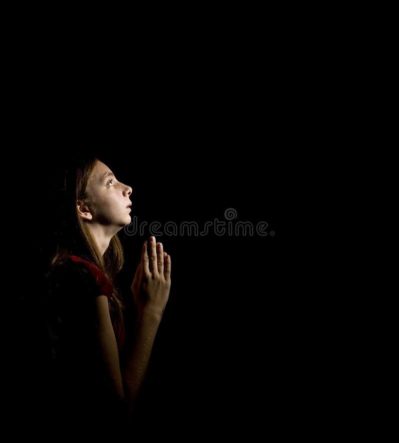 Muchacha adolescente en el rezo foto de archivo libre de regalías
