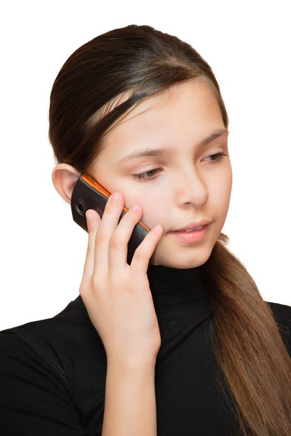 Muchacha adolescente joven que llama por el teléfono fotografía de archivo libre de regalías