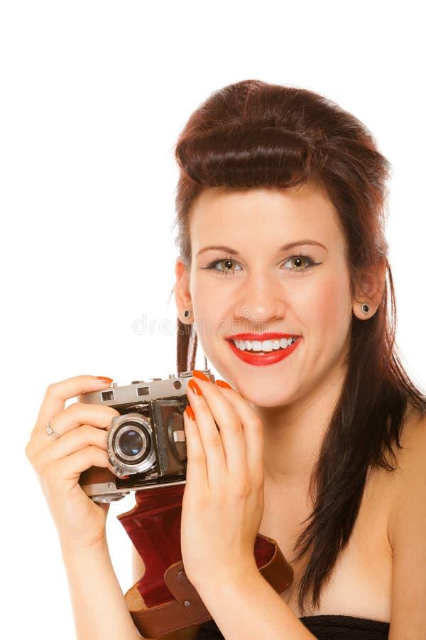 Muchacha adolescente preciosa con la cámara vieja fotos de archivo libres de regalías