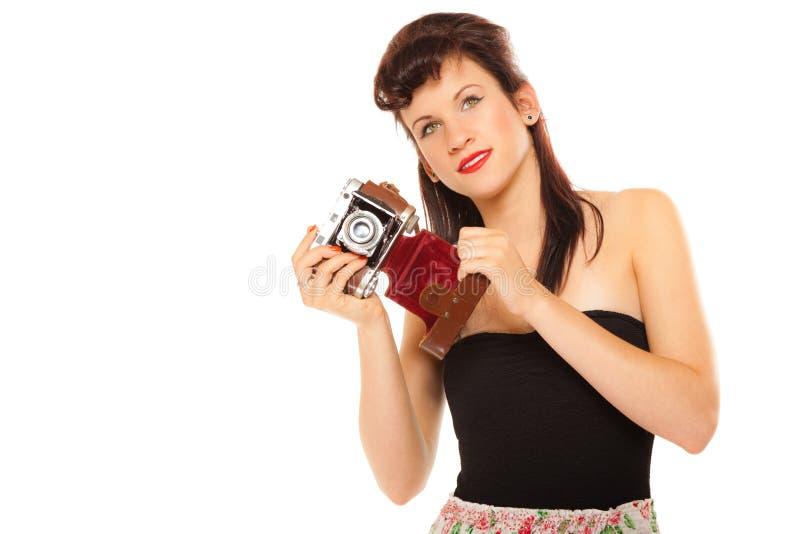 Muchacha adolescente preciosa con la cámara vieja foto de archivo libre de regalías