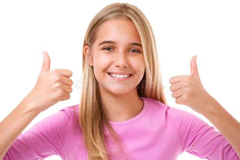 Muchacha adolescente sonriente feliz con la muestra aceptable de la mano Aislado imágenes de archivo libres de regalías