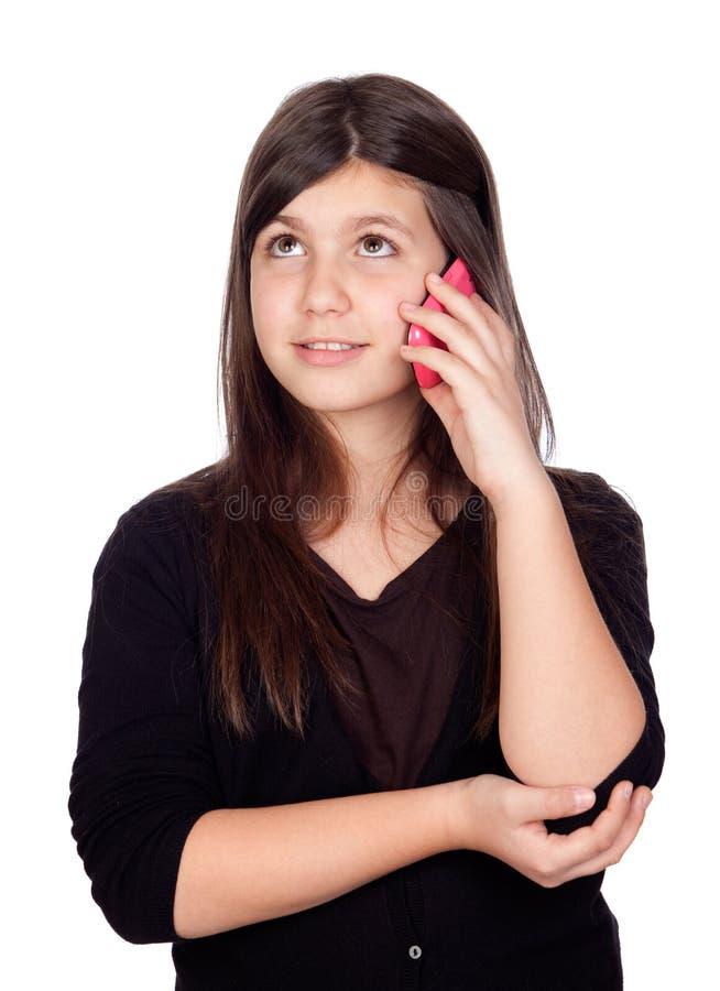 Muchacha adorable del preadolescente con un móvil fotografía de archivo