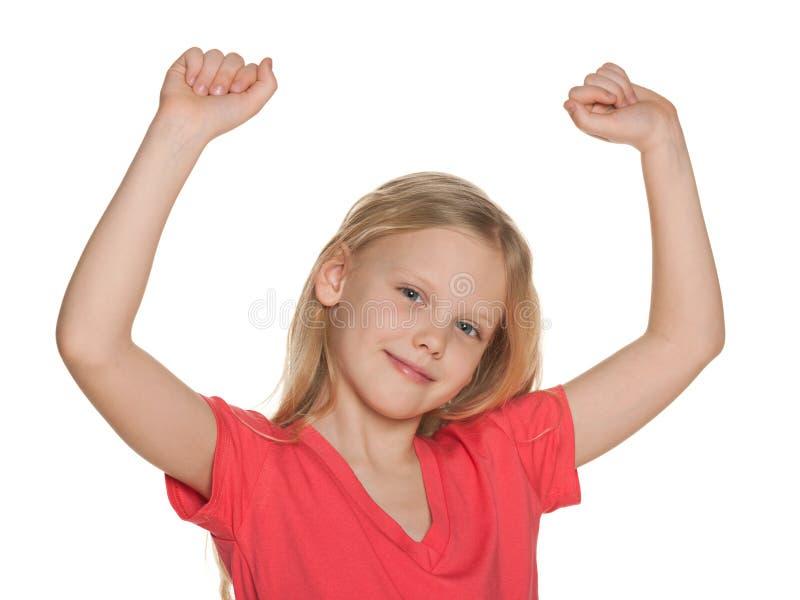 Muchacha afortunada con sus manos para arriba imagen de archivo